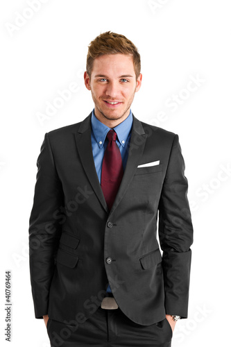 Handsome young businessman isolated on white