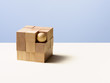Wooden ball in cube