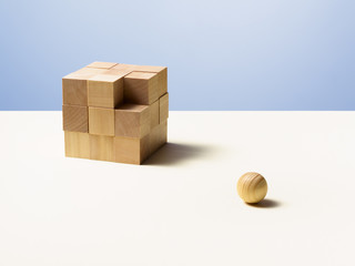 Wooden ball with wooden cube