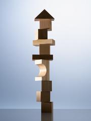 Stack of wooden blocks on table corner