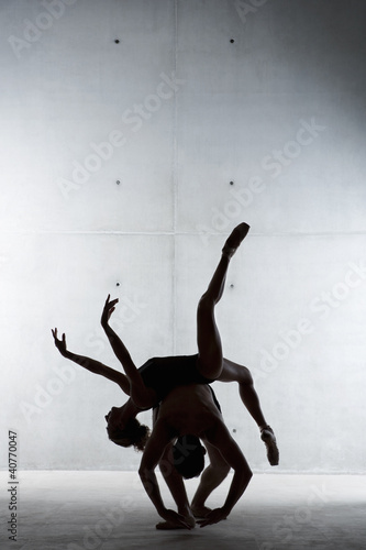 Silhouette of ballet dancers posing together