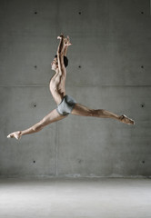 Ballet dancer posing in mid air