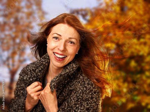 smiling woman in autumnal surrounding