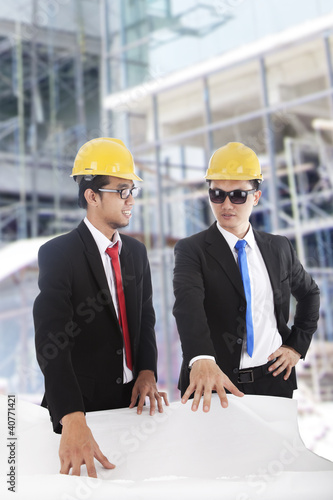 Engineers meeting at construction site