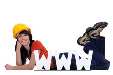 craftswoman posing behind a WWW ad