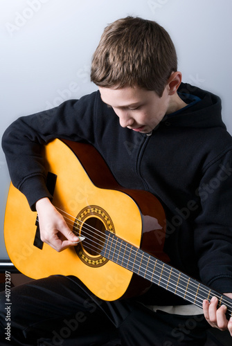 boy who plays guitar