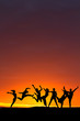 silhouette of friends dancing in sunset