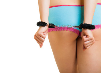 Girl in panties and handcuffs isolated on white