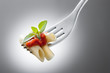 fork with macaroni and tomato