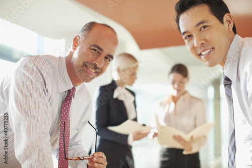 Businessmen talking in office