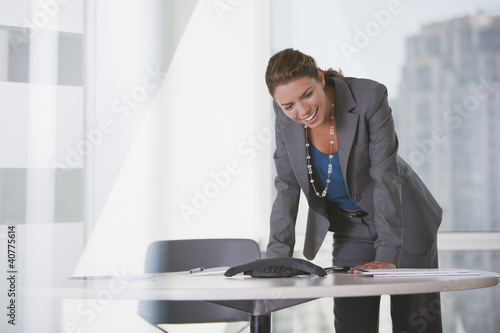 Businesswoman talking on speaker phone