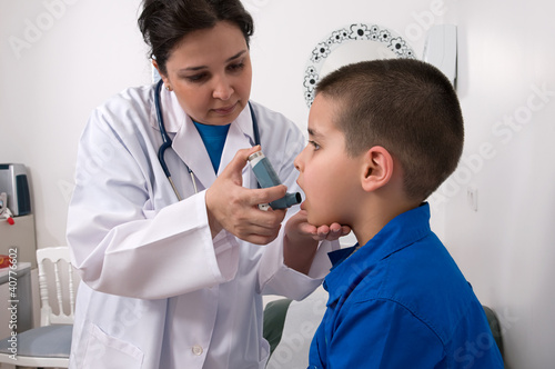 Medical doctor applying oxygen treatment on a little boy