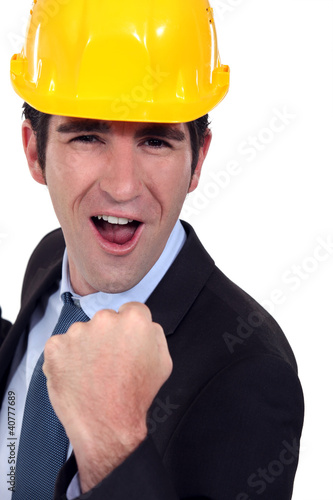 Man with helmet jubilant