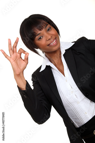 Afro-American businesswoman making an OK sign