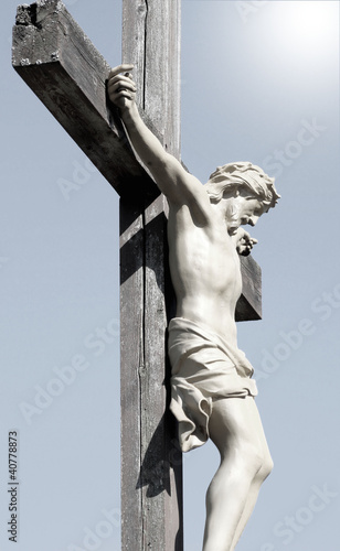 The Crucifixtion - Christ nailed to a cross, light shines above