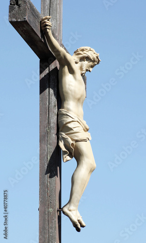 The Crucifixtion - statue of Christ nailed to a wooden cross