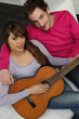 Couple playing the guitar