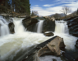Time lapse view of rocky waterfall