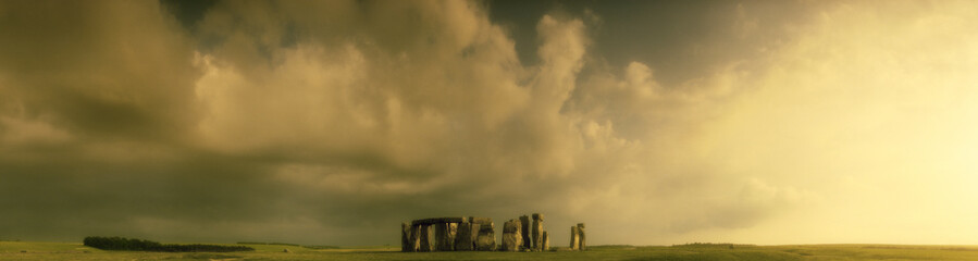 Stonehenge rock formations in rural landscape