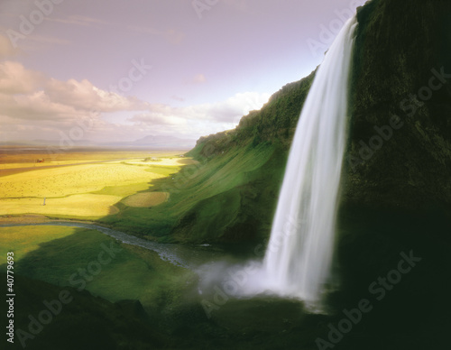 Time lapse view of waterfall over cliff