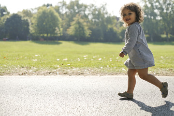 Toddler walking on road in park