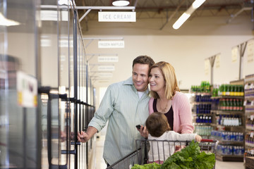 Family shopping together in supermarket