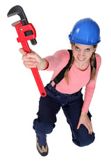 Female worker holding wrench