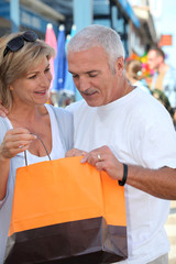 Mature couple looking at a store purchase