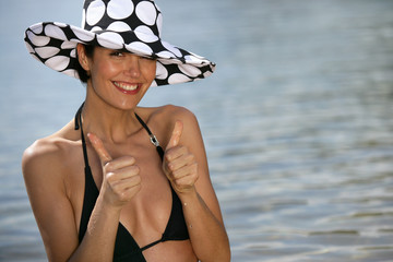 Thumbs up from a woman on the beach