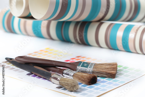 Paintbrushes, wallpapers, and color swatch