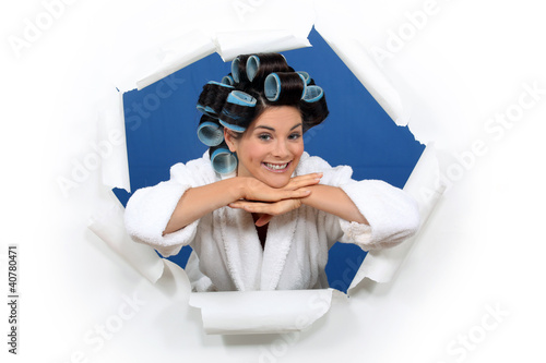 young woman with curlers in her hair posing