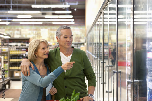 Older couple shopping in supermarket