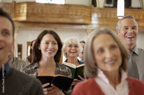 Congregation singing together in church