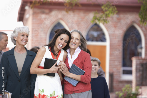 Older woman and granddaughter laughing