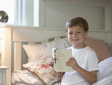 Boy reading Bible in bed