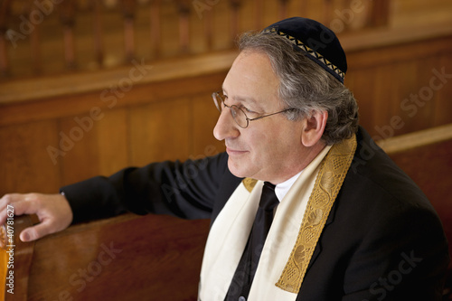 Rabbi sitting in synagogue pew