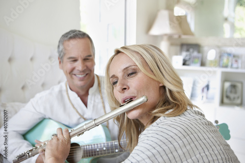 Older couple playing music together