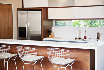 Stools and breakfast bar in modern kitchen
