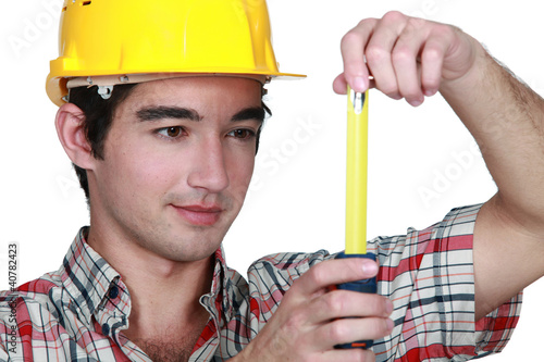 Builder holding tape measure