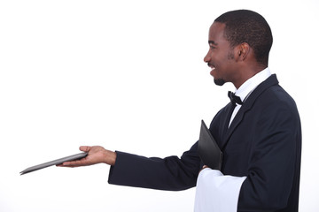 Profile of a waiter with a menu
