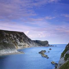 Rocky cliffs on still bay
