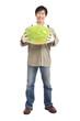 happy asian farmer holding watermelon full length