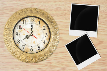 Clock, blank paper and photo frame on wooden background.