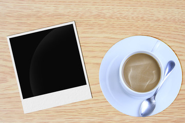 Coffee blank paper and photo frame on wooden background.