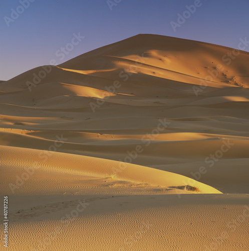 Sand dunes in rural landscape