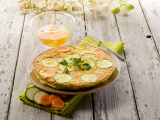 whole omelette with carrot zucchinis and parsley
