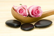 spa stones and pink roses