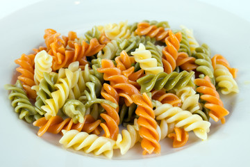 Spiral tricolor pasta on plate
