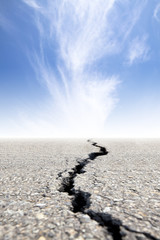 cracked road with cloud background