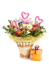 Beautiful bouquet in the basket and present box on a white backg